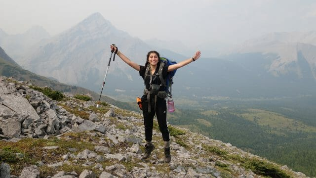 girl cheers on mountain