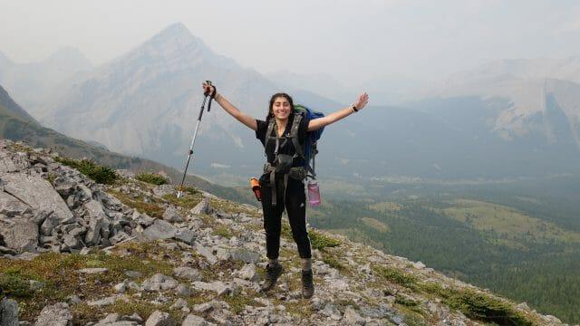 girl cheers on mountain
