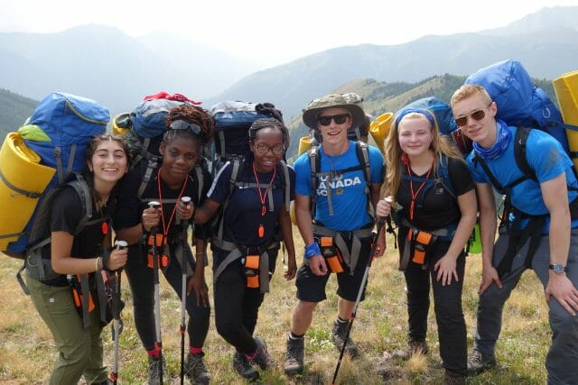 hiking students smiling at camera