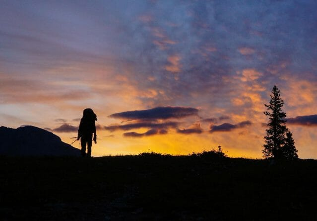 silhouette of hiker at sunset