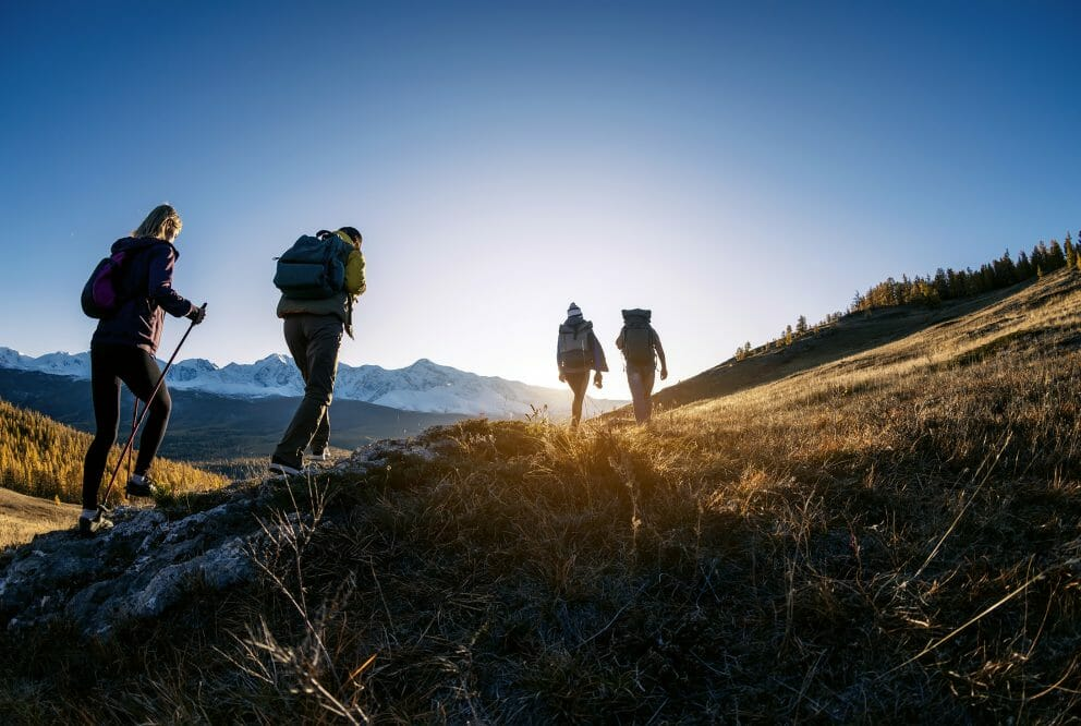 Hikers in mountains at sunset