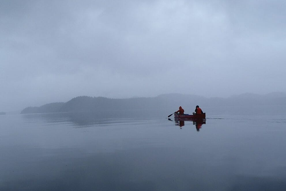 canoers on foggy lake