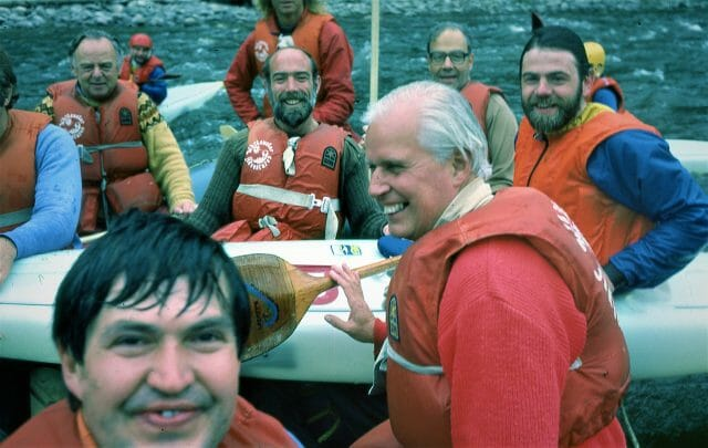 men in boat smiling at camera
