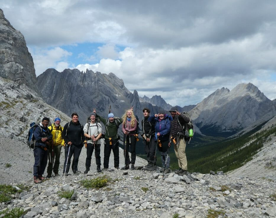 Group in front of mountains