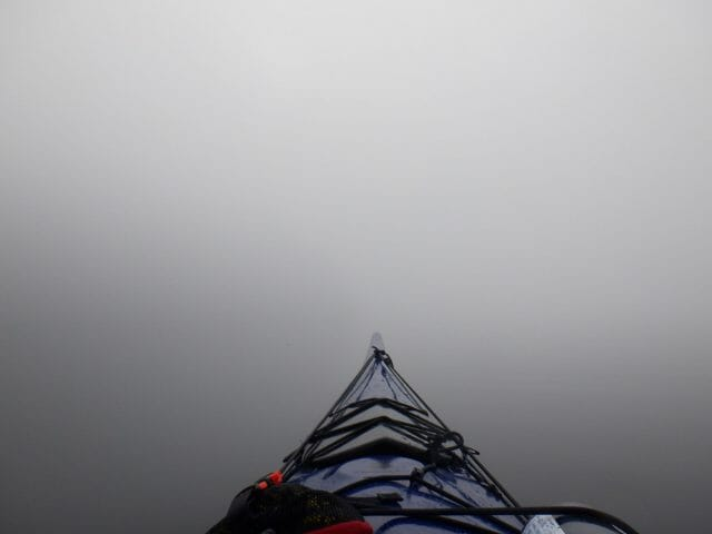 A kayak surrounded by fog
