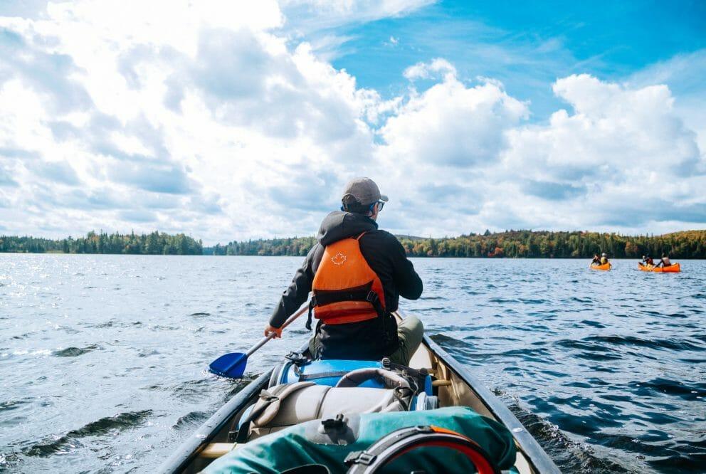 canoe paddler on sunny lake