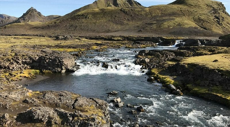 river going through mountains in iceland