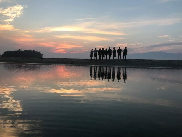 Silhouette of a group of people on shore