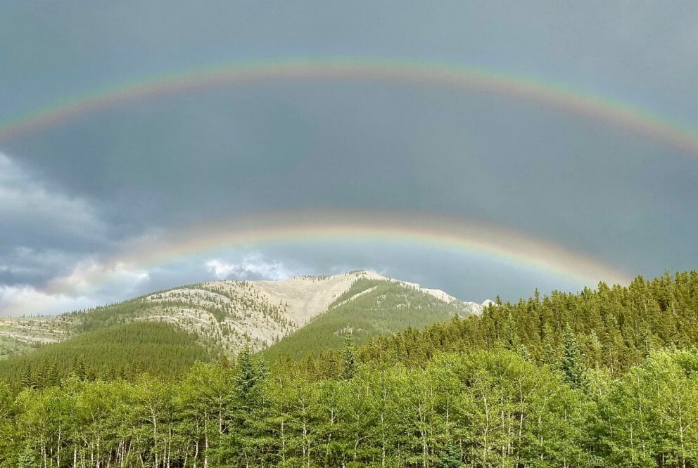Image of a double rainbow over a mountain