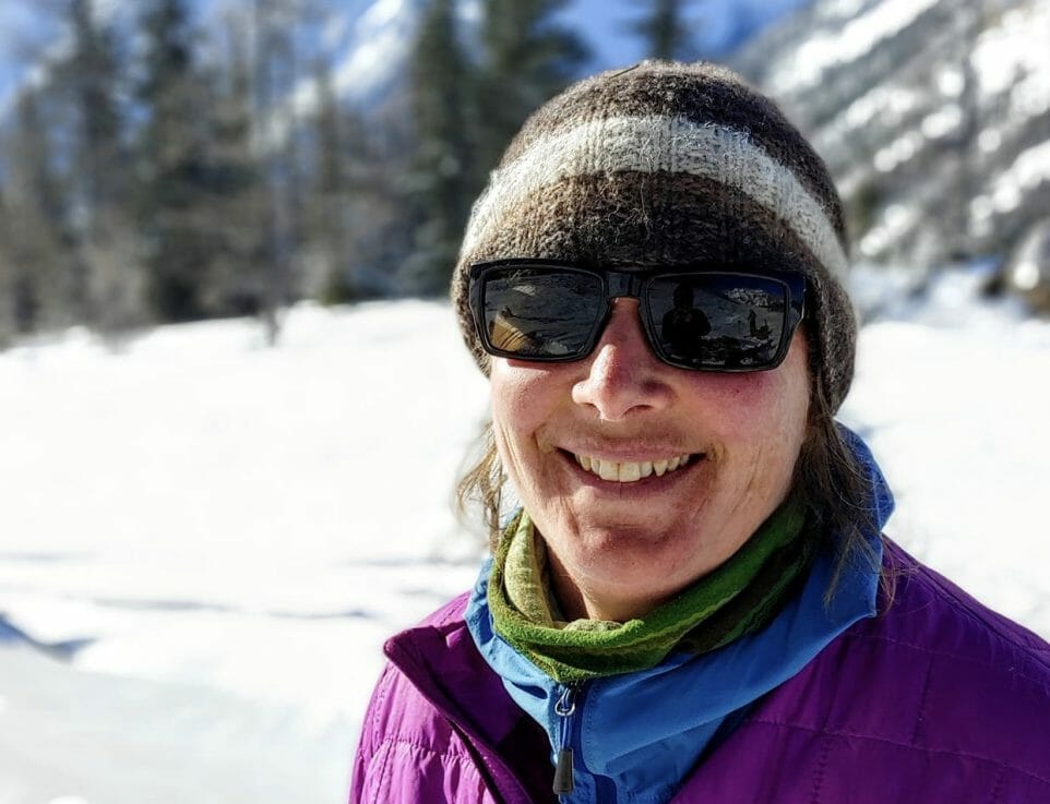Image of a person in a toque smiling